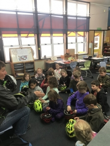 """The children had an extensive lesson on learning how to check and fit their bike helmets. Kath showed Room 3  children a helmet that had been in an accident and reinforced the message """"always wear your helmet""""."""